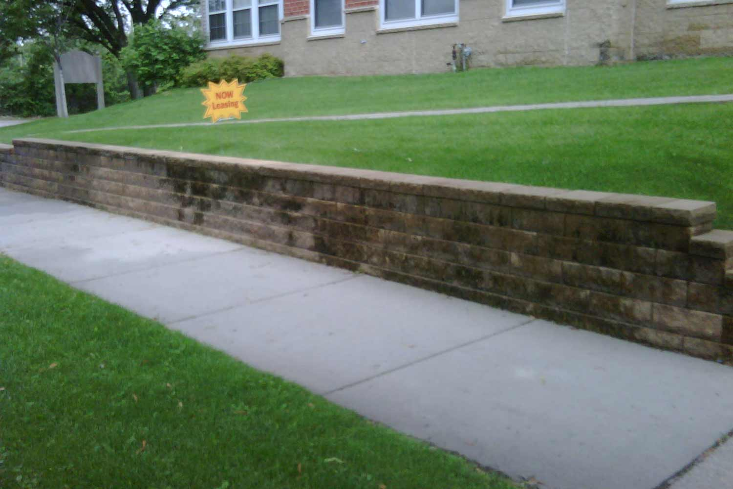 Commercial apartment building retaining wall renovation before.